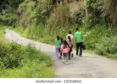 Caracas/Venezuela-April 22, 2018: A group of scholar kids leading by professor going to the outdoors to plant the Venezuelan national tree known as Araguaney (Tabebuia chrisantha) on the earth day