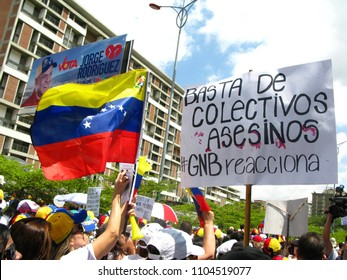 Caracas/Venezuela-February 15, 2014: Protesters ask for disarmament paramilitary criminal gangs or colectivos that emerged during the presidency of the late Chavez to guard his revolutionary program