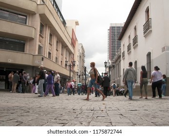 Caracas/Venezuela-January 07th, 2014: People walking on a busy street in the historic center downtown Caracas city Venezuela