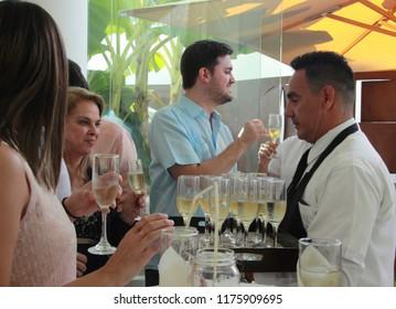 Caracas/Venezuela-January 14, 2018: people celebrating a party sharing wine drinks