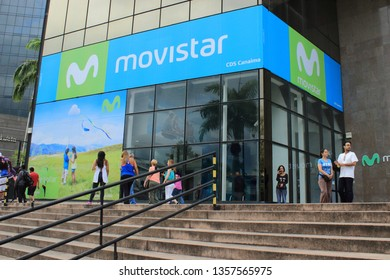 Caracas/Venezuela-July 03, 2017: People walking up stairs to the modern building of telecommunications operator Telefonica Movistar headquarters in Caracas