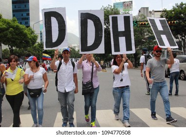 Caracas/Venezuela-June 27, 2017. Protestors against dictatorship Nicolas Maduro hold up signs for human rights at a protest march during the Day of the Journalist