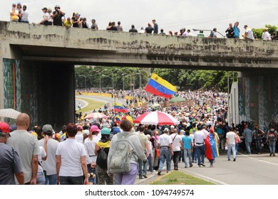 Caracas/Venezuela-June19, 2017: Anti Nicolas Maduro protesters marching to the National Electoral Council (CNE) in a massive demonstration against the dictatorship