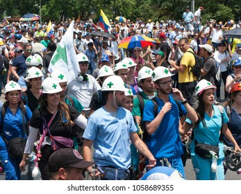 Caracas/Venezuela-The mother of all protests in Venezuela against Nicolas Maduro government. First responders known as White helmed, green crosses during main protest in Caracas Venezuela