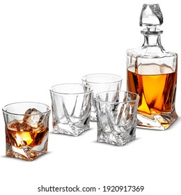 Carafe and glasses of whiskey isolated on a white background