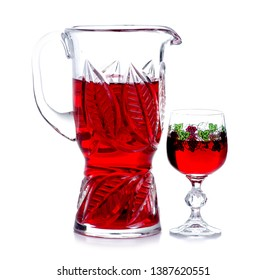 A carafe of homemade wine with glasses on a white background. Isolation