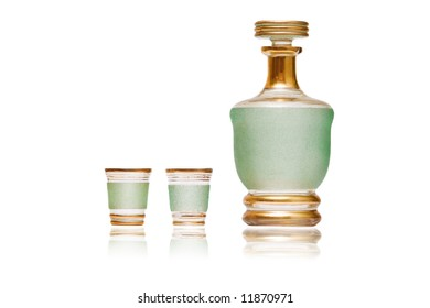carafe with two glasses isolated on white