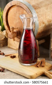carafe of wine on the background of the barrel