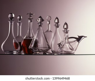 Carafes with red wine on glass table