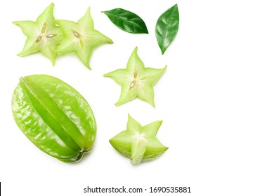 Carambola with green leaves and slices isolated on white background. top view