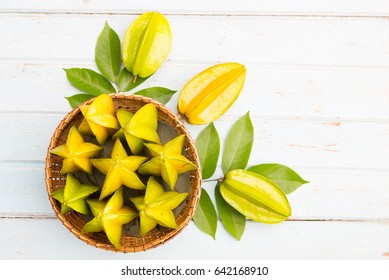 Carambola Plant, Star Fruit (Averrhoa carambola L.) fruit of Thailand medicinal properties.Carambola Plant, Top view star Fruit over old wood desk