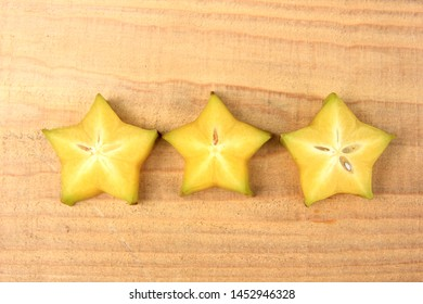 Carambola or star apple ( starfruit ) on old wooden background,Close up healthy carambola or star apple food .