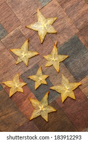 Carambola - star fruit slices on wooden background