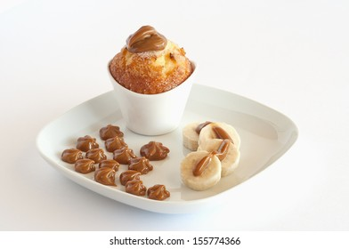 Caramel (also known as Dulce de Leche) used in sweets desserts on plates over a white background.