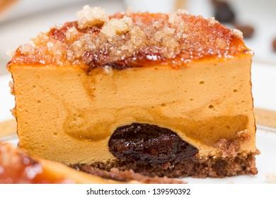 Caramel cake with chocolate cream and caramelized sugar over, macro