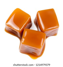 Caramel candies with caramel sauce isolated on a white background Macro