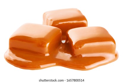 Caramel candies and sauce isolated on a white background. With clipping path.