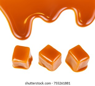Caramel candies and caramel sauce isolated on a white background. Golden Butterscotch toffee candy
