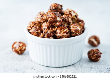 Caramel and chocolate sweet Popcorn in a white bowl. toning. selective focus