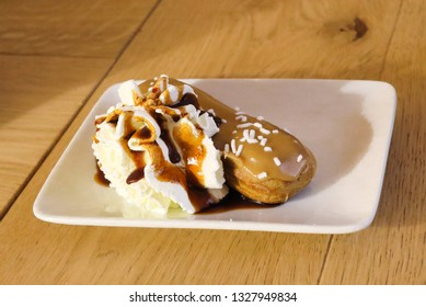caramel choux pastry with creme on white plate