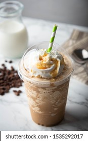 caramel frappe with wipped cream on marble table