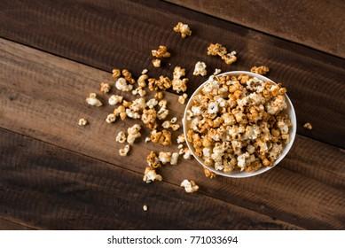 caramel popcorn on wooden table background. caramel flavoured popcorn in bowl