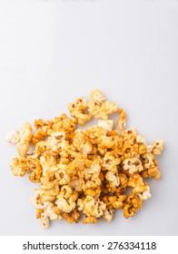 Caramel popcorn over white background