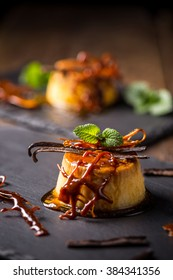 Caramel pudding with vanilla, mint and caramel decoration