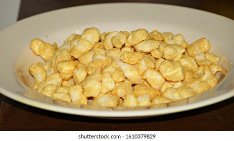 Caramel puffs, sweet background and texture, close-up