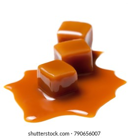 Caramel with sauce. Golden Butterscotch toffee candy caramels. Sweets  with copy space, macro.