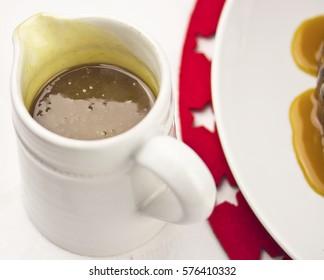 Caramel sauce in jug