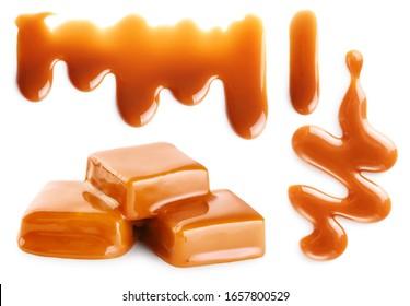 Karamelllspritzen und karamellige Bonbons einzeln auf weißem Hintergrund.  Geschüttelte Karamellsoße mit Beschneidungspfad.