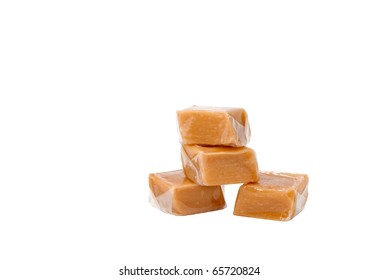 Caramel sweets in plastic wrap, isolated