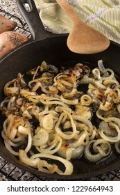 caramelized organic onion rings in a cast iron pan