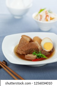 Caramelized pork and eggs is a Vietnamese traditional food consisting of marinated pork and boiled eggs braised in coconut juice.