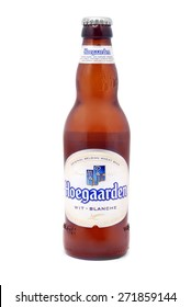 CARANSEBES, ROMANIA - DECEMBER 15, 2011: Hoegaarden beer bottle on white, Hoegaarden Brewery is a brewery in Hoegaarden, Belgium, and the producer of a well known wheat beer.