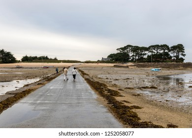 CARANTEC, FRANCE - Aug 8, 2018: The submersible passage to Ile Callot, a tidal island only accesible al low tide in the coast of Brittany (Bretagne)