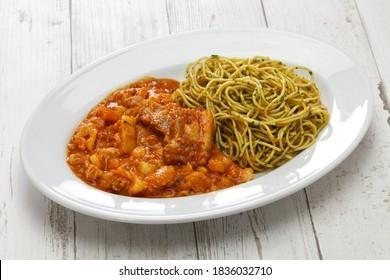 carapulcra con sopa seca, peruvian dried potato stew with basil pasta
