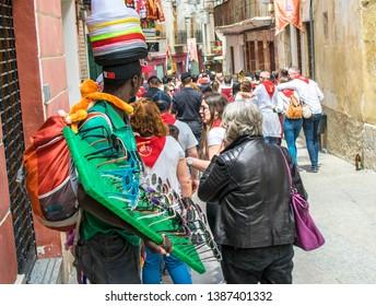 Caravaca de la Cruz, Spain, May 2, 2019: Black male selling sun glasses at Los Caballos Del Vino or Horses of Wine