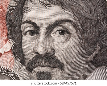 Caravaggio portrait on 100000 italian lire banknote closeup macro. One of the greatest and innovative painter of the Renaissance.
