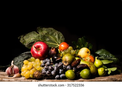 A Caravaggio's styled and lighted still life of fruits and vegetables. All the ingredients were available before 800ad in central europe.