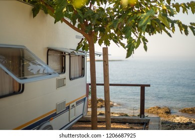 Caravan in camping ground on mediterranean seaside.