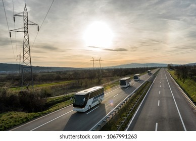 Caravan or convoy of busses in line on a country highway