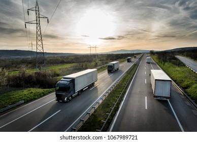 Caravan or convoy of trucks in line on a country highway