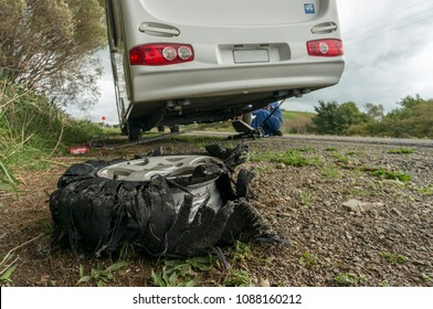Caravan flat tyre on side of road with roadside assistance changing the tyre.