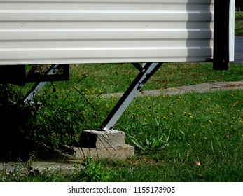 A Caravan Leg is used to Stabilise and Support the Weight and Movement of the Mobile Holiday Home, with the Aid of Blocks for Raising the Temporary Static Trailer on Uneven Ground.