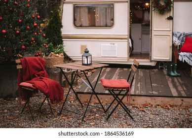 Caravan mobile home with terrace, Mobile home decorated with Christmas decor. Festive atmosphere - lights, red blankets, Christmas trees. Waiting for the snow. Caravan camping. mobile home trailer. - Shutterstock ID 1864536169