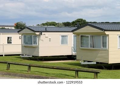 Caravan mobile homes in modern trailer park.