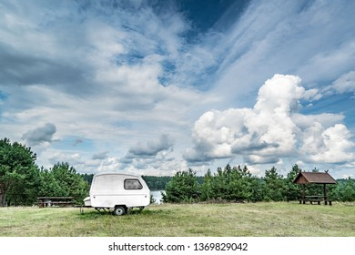 Caravan on resting place with summer clouds