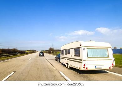 Caravan or recreational vehicle motor home trailer on a freeway road